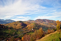 The mountain autumn landscape with colorful forest. Mountain autumn landscape with colorful forest, rural village Stock Photos