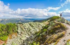 Mountain autumn landscape with single tourist on the ridge Royalty Free Stock Image