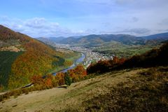 Mountain autumn landscape, view from ski elevator to small town Stock Photography