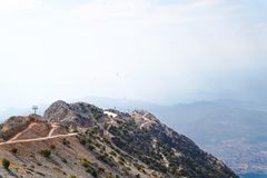 Mountain Babadag is ideal place for paragliding. And some paragliders flying on the mountain and Fethiye city and Mediterranean sea in background royalty free stock images