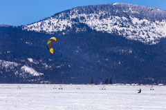 Mountain in back of kite boarder. Kite boarding on the snow on the Rathdrum Prairie in north Idaho Royalty Free Stock Photo
