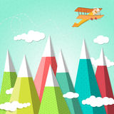 Mountain background with a biplane Stock Images