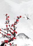 Mountain background with cherry flowers and crane birds. Stock Photo