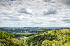 Mountain background with farms, trees, plants, green vegetation Royalty Free Stock Images