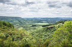 Mountain background with farms, trees, plants, green vegetation Royalty Free Stock Photography