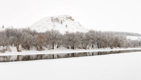 Mountain on a background of the ice river. Winter landscape in R Royalty Free Stock Photos