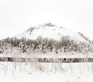 Mountain on a background of the ice river. Winter landscape in R Stock Photos