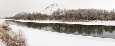 Mountain on a background of the ice river. Winter landscape in R Stock Image