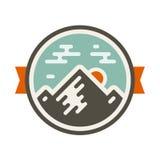 Mountain badge. Round mountain badge icon with orange accents Royalty Free Stock Photo