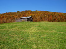 Mountain barn in autumn Stock Images