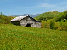 Mountain barn in spring Royalty Free Stock Photo