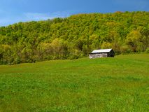 Mountain barn in spring Royalty Free Stock Images