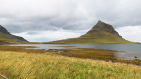 Mountain Beyond the Lake. Green mountain beyond vast Icelandic lake Stock Image