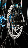 Mountain bicycle disk brake system on dark background Royalty Free Stock Photos