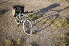 Mountain bicycle equipped with rear pannier bags for Bicycle touring Royalty Free Stock Photography
