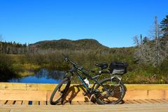 Mountain bike on a logging bridge. A mountain bicycle parked on a logging bridge in the Adirondack Mountains wilderness royalty free stock images