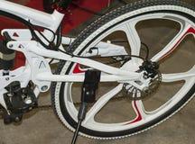 Bicycle brake system. Mountain bicycle rear wheel with mechanical disc brake Royalty Free Stock Photo