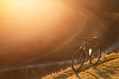Mountain bicycle standing in the hill trail. Royalty Free Stock Photo