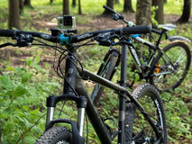 Mountain bicycles with GoPro 3+ BE mounted on handlebar in the f Stock Image