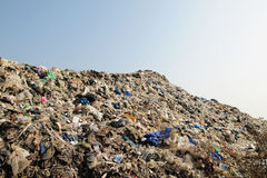Mountain of big garbage. Bad bag bulldozer conservation dirty discard dispose dump dumping environment fill garbage horizontal industry land landfill litter Royalty Free Stock Image