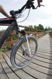 Mountain bike. Low angle view of a mountain bike across a wooden walkway Royalty Free Stock Photography