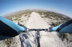 Mountain bike. Forefront of the handlebars of a bicycle on a walk through a barren landscape Stock Photos