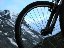 Mountain bike. Sky and mountain through a bicycle wheel Royalty Free Stock Photography