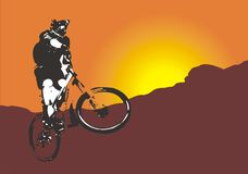 Mountain bike. R on hill with sun in the background Royalty Free Stock Photography