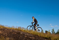 Mountain bike. Young man on a mountain bike Royalty Free Stock Photo