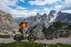 Mountain bike alpcross in the dolomites. A biker on a path in high altitude Royalty Free Stock Photos