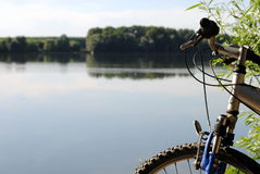 Mountain bike close to a river Royalty Free Stock Photo