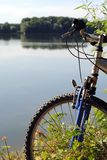 Mountain bike close to a river Stock Photo