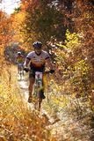 Mountain bike competition in autumn forest Royalty Free Stock Photography