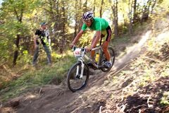 Mountain bike competition in autumn forest Stock Images