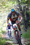 Mountain bike competition in forest Stock Photography