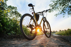 Mountain bike on the countruside road on sunset Royalty Free Stock Photography