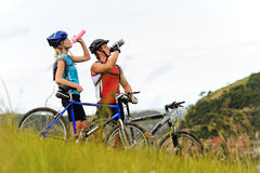 Mountain bike couple drinking Royalty Free Stock Image