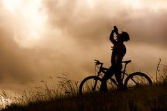 Mountain bike couple drinking Stock Photos