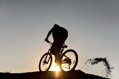 Mountain bike and crazy rider & spin the rider. Mountain bike and crazy rider.sunrise and biker.Healthy and fresh day.Happy and relaxing man.Dream ve freestyle royalty free stock photo