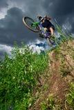 Mountain bike cyclist doing wheelie stunt on a mtb bike Royalty Free Stock Photos