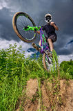 Mountain bike cyclist doing wheelie stunt on a mtb bike Stock Photos