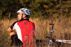 Mountain Bike cyclist resting outdoor with his bike Stock Images
