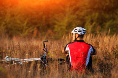 Mountain Bike cyclist resting outdoor with his bike Royalty Free Stock Photo