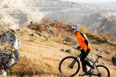Mountain Bike cyclist riding Meadow track Royalty Free Stock Photos