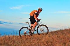 Mountain Bike cyclist riding outdoor Stock Image