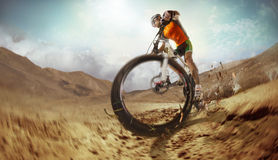 Mountain Bike cyclist riding single track. Sport. Mountain Bike cyclist riding single track in desert Royalty Free Stock Photography