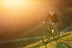 Mountain Bike cyclist riding single track at sunrise, healthy life Stock Image