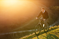 Mountain Bike cyclist riding single track at sunrise, healthy life Royalty Free Stock Photography
