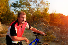 Mountain Bike cyclist riding single track at sunrise. Healthy lifestyle active athlete Royalty Free Stock Image