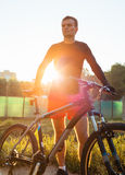 Mountain bike cyclist riding at sunrise healthy lifestyle doing Stock Photography